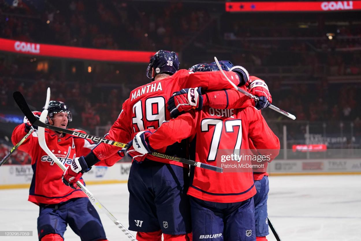 T.J. Oshie celebrates with teammates after scoring Washington's first goal in Game 2/Photo: Patrick McDermott/Getty Images