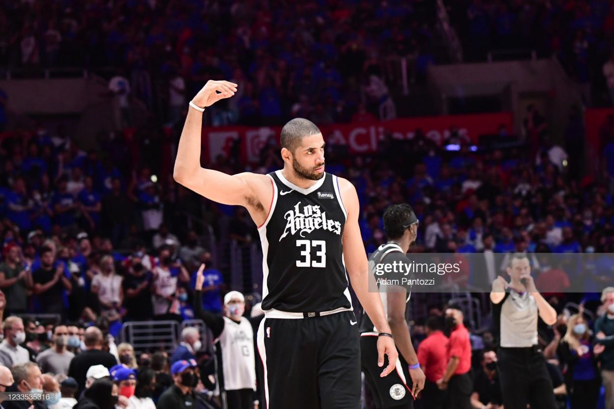 LOS ANGELES, CA - JUNE 18: Nicolas Batum #33 of the LA Clippers pumps up the crowd during the game against the Utah Jazz during Round 2, Game 6 of the 2021 NBA Playoffs on June 18, 2021 at STAPLES Center in Los Angeles, California. NOTE TO USER: User expressly acknowledges and agrees that, by downloading and/or using this Photograph, user is consenting to the terms and conditions of the Getty Images License Agreement. Mandatory Copyright Notice: Copyright 2021 NBAE (Photo by Adam Pantozzi/NBAE via Getty Images)