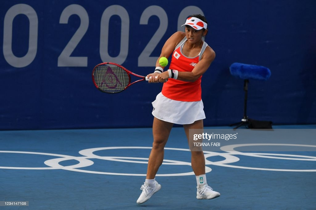 Doi hits a backhand during her first=round victory/Photo: Tiziana Fabi/AFP via Getty Images