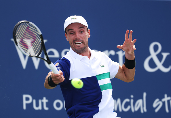 Several of our writers are picking Bautista Agut to struggle (Image: Al Bello)