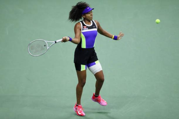 Osaka hits a forehand in her quarterfinal victory/Photo: Matthew Stockman/Getty Images