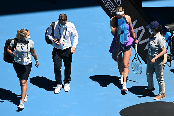 Azarenka walks off the court to receive a medical timeout (Quinn Rooney/Getty Images)
