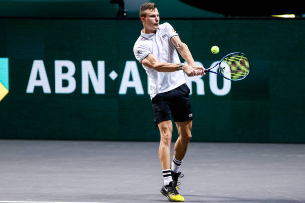 Fucsovics plays a backhand during his semifinal victory/Photo: Hans van der Valk/BSR Agency/Getty Images