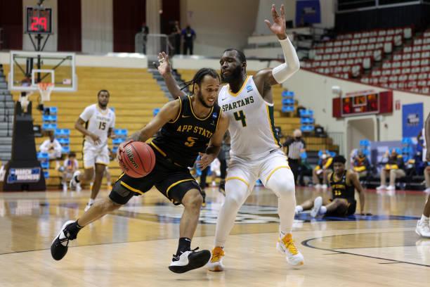 Michael Almonacy of Appalachian State (l.) drives past Joe Bryant Jr. of Norfolk State (r.) during their First Four game/Photo: Stacy Revere/Getty Images