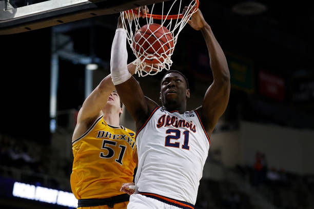 Illinois' Kofi Cockburn dunks over Drexel's James Butler during their first-round NCAA Tournament game/Photo: Maddie Meyer/Getty Images