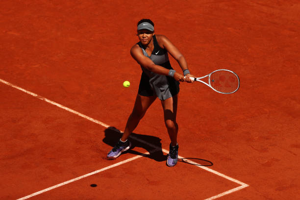 Osaka plays a backhand during her first-round victory/Photo: Julian Finney/Getty Images