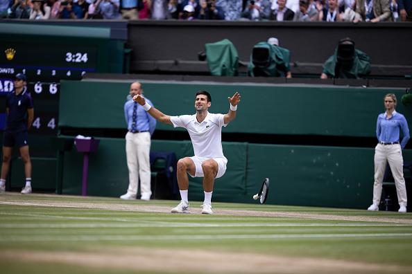Djokovic celebrates his win at Wimbledon (Simon Bruty/Getty Images)