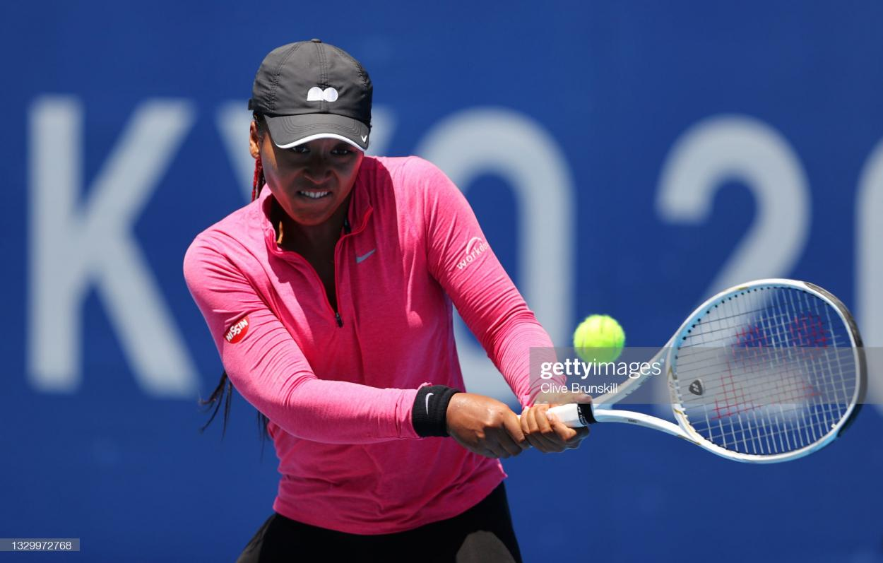 Osaka plays a backhand in practice in preparation for the Olympics/Photo: Clive Brunskill/Getty Images