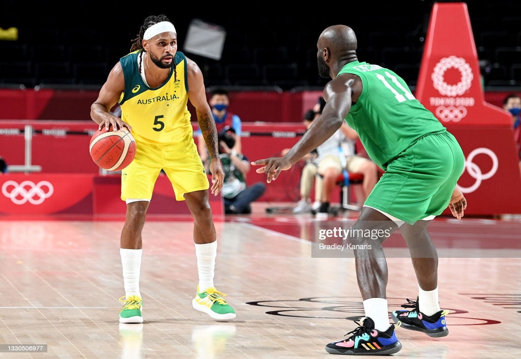 Mills (l.) is guarded by Nigeria defender Obe Emegano (r.) during the teams' opening group game at the Olympics/Photo: Bradley Kanaris/Getty Images