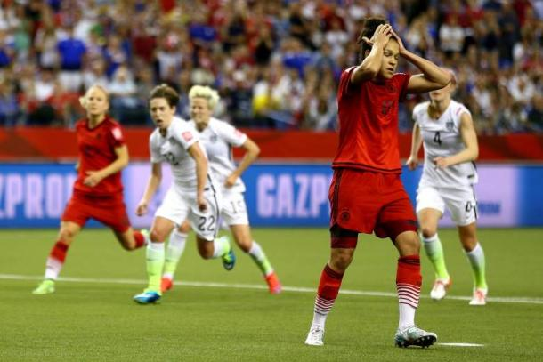 Celia Sasic in disbelief over her missed penalty against the United States in the semifinals of the 2015 Women's World Cup. Photo provided by Getty Images.