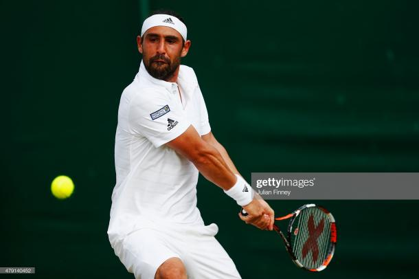 Baghdatis in action at Wimbledon in 2015 (Getty Images/Julian Finney)