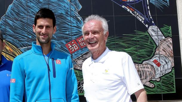 Djokovic poses with Raymond Moore. Credit: Matthew Stockman/Getty Images
