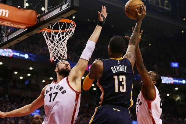 Paul George attempts a layup over Jonas Valanciunas (17) (NBAE/Getty Images)