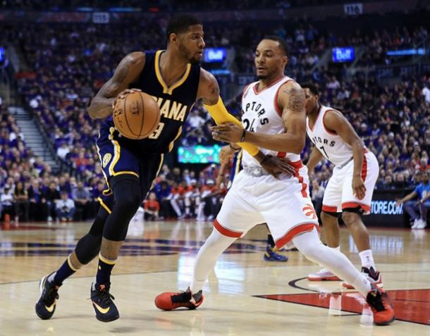 Paul George (13) attacks Norman Powell (NBAE/Getty Images)