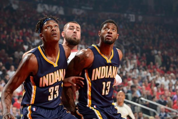 Myles Turner (33) and Paul George (13) box out Jonas Valanciunas for a rebound (NBAE/Getty Images)