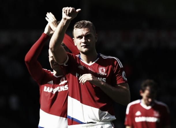 Ben Gibson thanks the travelling fans from Teesside after captaining Boro to a clean sheet | Photo: Getty Images