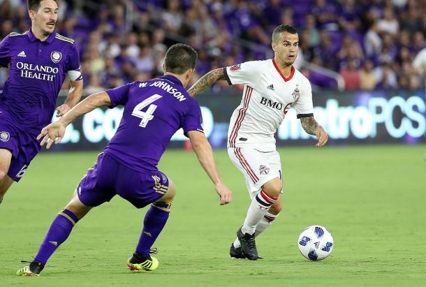 Giovinco dribbles at Will Johnson | Source: The Globe and Mail