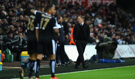 Monk (pictured, far right) during his last fixture in charge of Swansea, a 3-0 home defeat against Leicester last weekend