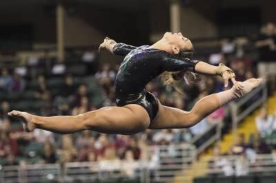 Ashleigh Gnat on Beam credit: LSU Sports