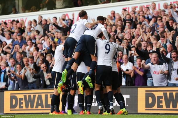 Spurs celebrate their winning goal on Saturday (photo: Reuters)