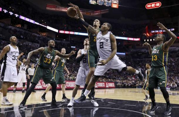 Will Kawhi Leonard win the Defensive PLayer of the Year for the third straight year or will Rudy Gobert anchor in his defense and block his attempt in winning three-in-a-row? Photo: Edward A. Ornelas /San Antonio Express-News