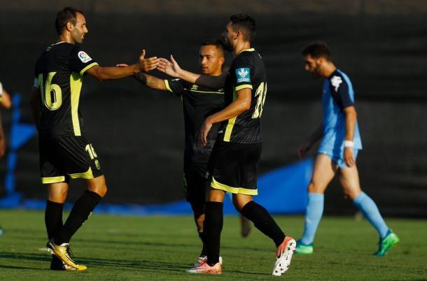 Víctor Díaz, Juancho y Puertas celebran un gol esta pretemporada | Foto: Pepe Villoslada - Granada CF