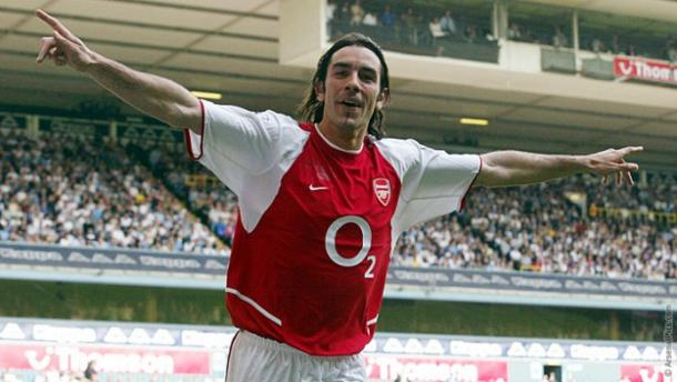 Robert Pires scores at White Hart Lane to clench the title in 2004. | Source: Arsenal