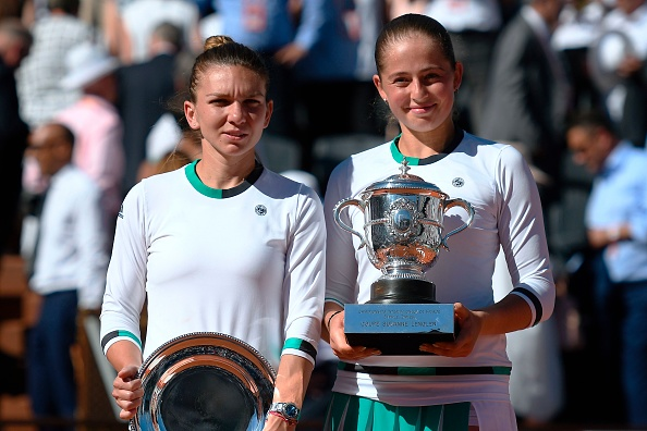The two finalists holding their respective trophies (Photo by Lionel Bonaventure / Getty)