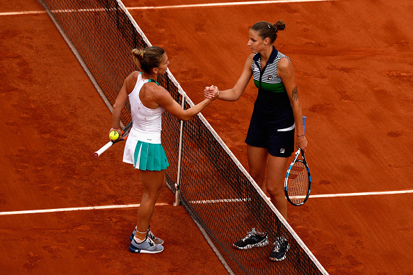 The duo shook hands at the net with Halep denying Pliskova the chance to reach a second Slam final (Photo by Adam Pretty / Getty)