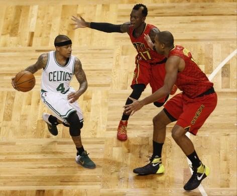 Celtics Guard Isaiah Thomas tries to get past Atlanta's defenders guard Dennis Schroder and Center Al Horford