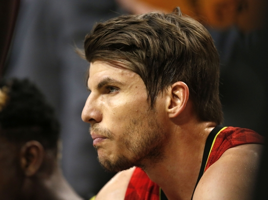 Guard Kyle Korver takes a rest and looks on from the bench.