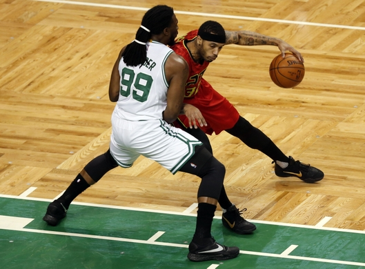 Hawks forward Mike Scott posts up against Celtics forward Jae Crowder