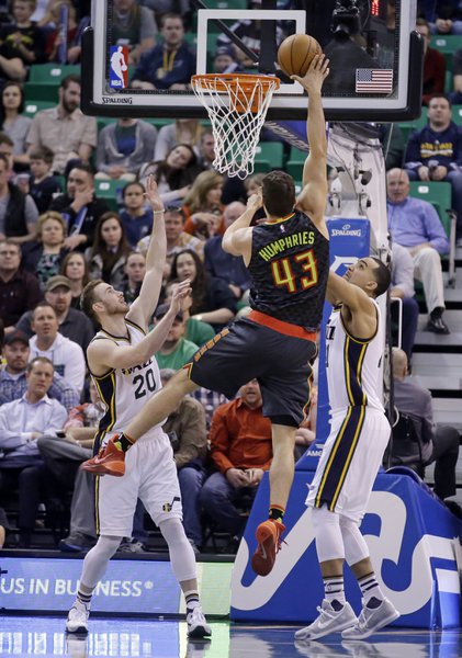 Atlanta Hawks' Kris Humphries takes a shot defended by Utah Jazz's Gordon Hayward and Trey Lyles. | Associated Press