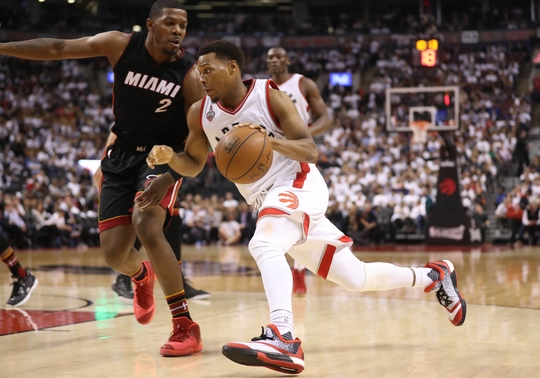 Toronto Raptors Guard Kyle Lowry drives to the basket against Miami Heat forward Joe Johnson. Photo Credit:Tom Szczerbowski-USA TODAY Sports