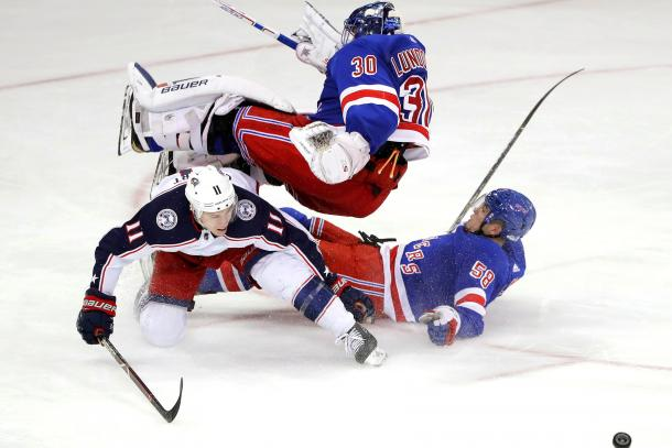 Henrik Lundqvist takes a nasty spill, but gets back up to finish the game. (Photo: New York Post)