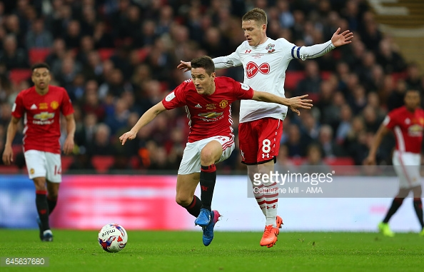 Ander Herrera shrugs Steven Davies off the ball on Sunday