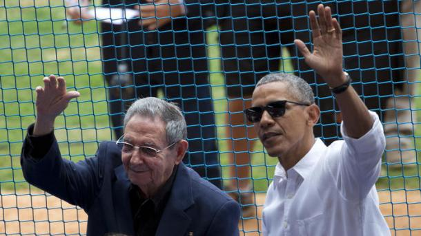 (Rebecca Blackwell / AP) U.S. President Barack Obama and his Cuban counterpart Raul Castro wave to cheering fans as they arrive for the game in Havana, Cuba, on Tuesday, March 22, 2016.