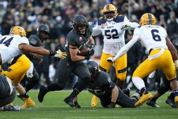 The Navy Midshipmen defend the rush against the Army Black Knights at M&T Bank Stadium in Baltimore/Getty Images