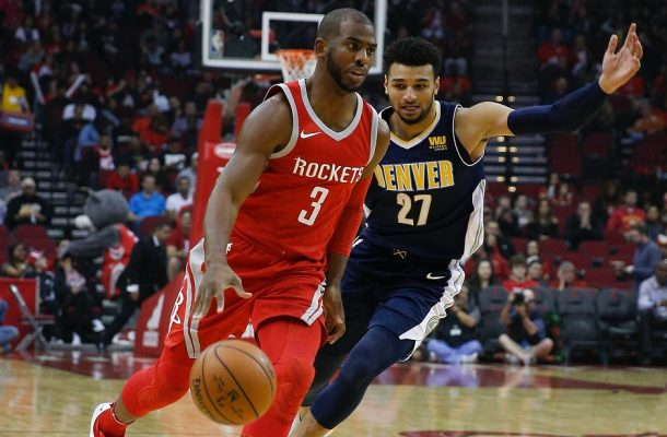Houston's Chris Paul being guarded by Denver's Jamal Murray. Photo: Bob Levey/Getty Images