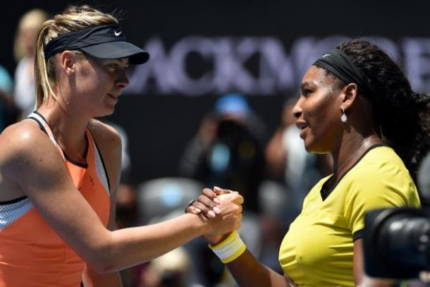 Serena Williams and Maria Sharapova meet at the net after their match|Photo: Saeed Khan/Getty Images