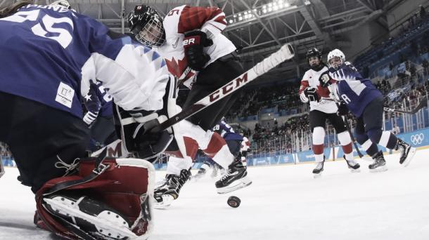 Canada's Jennifer Wakefield tries to get the puck past USA's goalie Maddie Rooney in the women's gold medal ice hockey match between Canada and the U.S. at the Pyeongchang 2018 Winter Olympic Games. | Photo: AFP/Getty Images