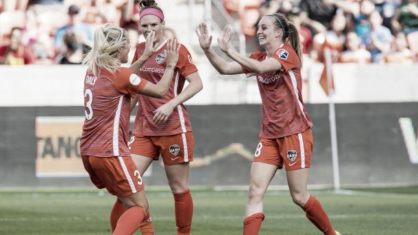Rachel Daly congratulating Kimberly Keever after a goal during the season opener against the Chicago Red Stars |  Photo: Wilf Thorne/isiphotos.com