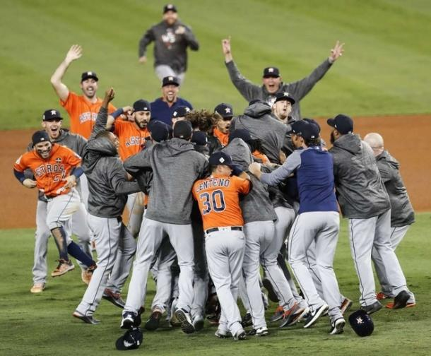 The Astros pour onto the field after winning the World Series/Photo: Brett Coomer/Houston Chronicle