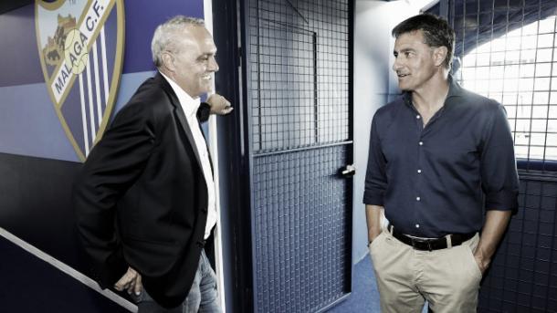 Husillos conversa con Míchel | Foto: Málaga CF.