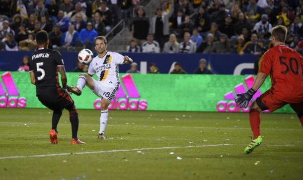 Mike Magee chipping the ball into the back of the net at 64th minute for his first goal of the match against D.C. United on Sunday. Photo provided by Vicor Decolongon-Getty Images.