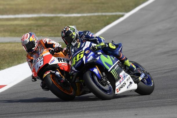 Rossi and Pedrosa come close as the Spaniard gets passed the Italian to take the lead - www.valentinorossi.com