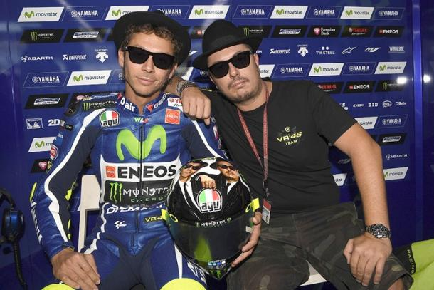 Rossi and Ucio posing with the special Blue's Brothers helmet design for the Italian's home GP - www.valentinorossi.com