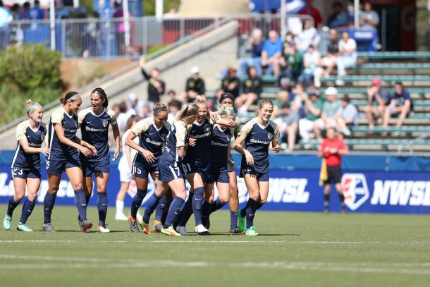 Merritt Mathias celebrates goal with team | Photo: North Carolina Courage