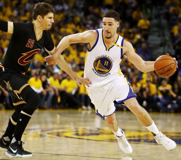 Klay Thompson #11 of the Golden State Warriors is defended by Kyle Korver #26 of the Cleveland Cavaliers during the second half of Game 2 of the 2017 NBA Finals |Source: Getty Images / Ezra Shaw|