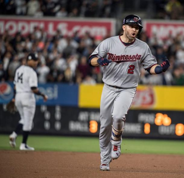 Minnesota Twins' Brian Dozier rounds third base after hitting a solo home run against the New York Yankees |Source - Newsday / J. Conrad Williams Jr|